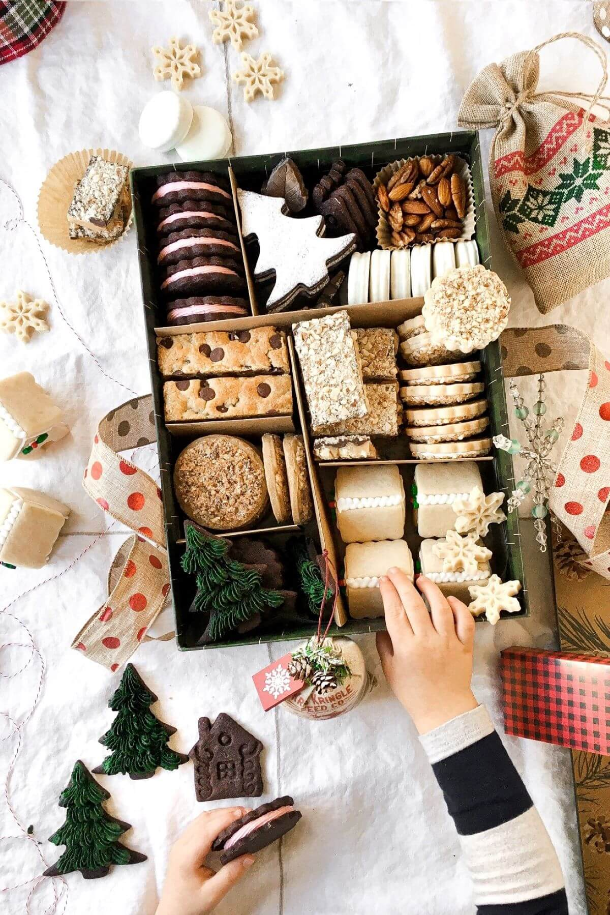 A box full of Christmas cookies.