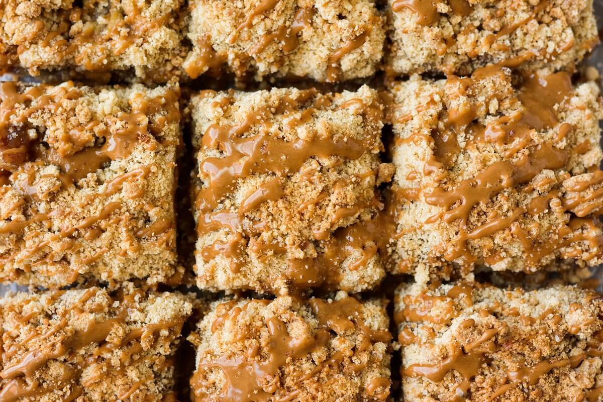 Closeup of apple crumb bars with maple icing.
