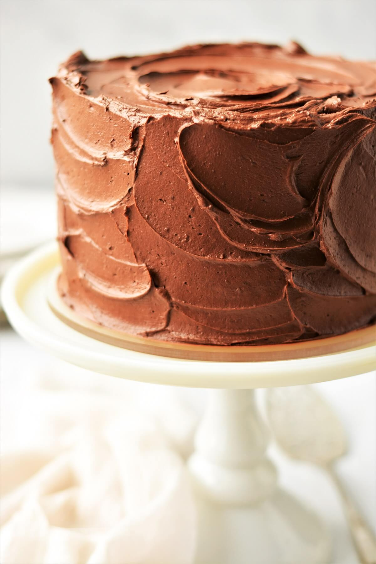 Closeup of chocolate buttercream on a layer cake.