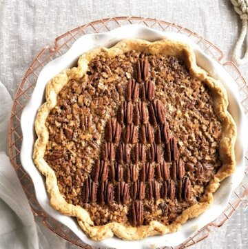 A pecan pie with the pecans arranged on top of the pie like a Christmas tree.