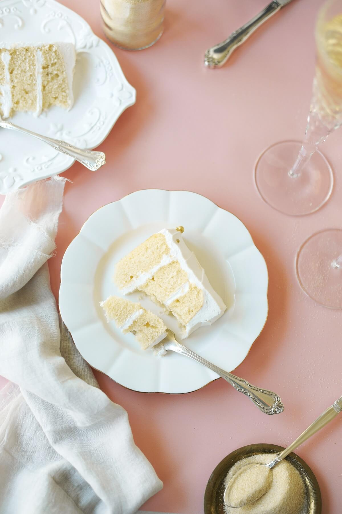 Slices of toasted sugar champagne cake on white plates.
