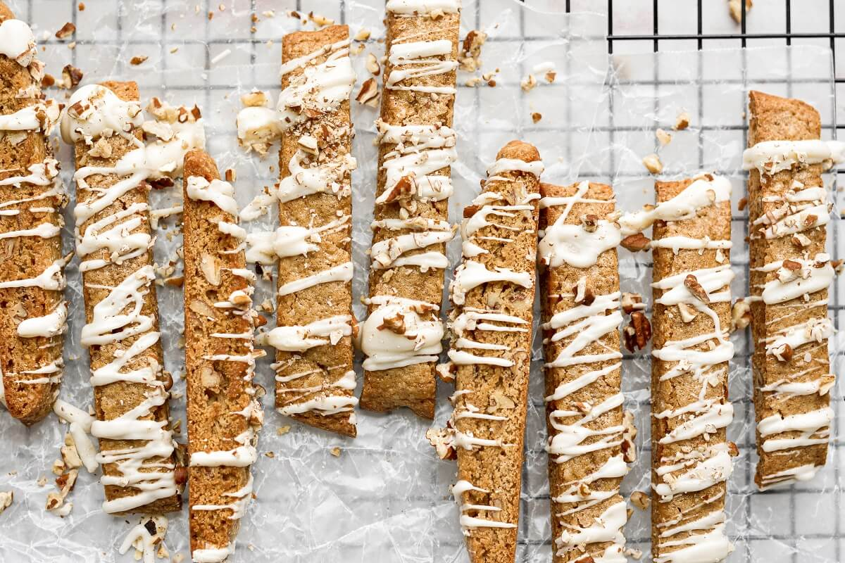 Butter pecan biscotti on a black cooling rack.