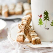 Butter pecan biscotti next to a Christmas mug.