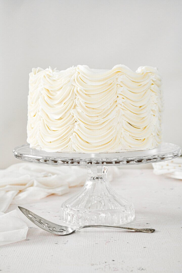 Cardamom cake with piped swoops of eggnog buttercream.