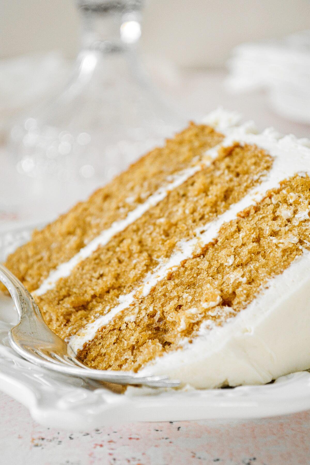 A slice of cardamom cake with eggnog buttercream.