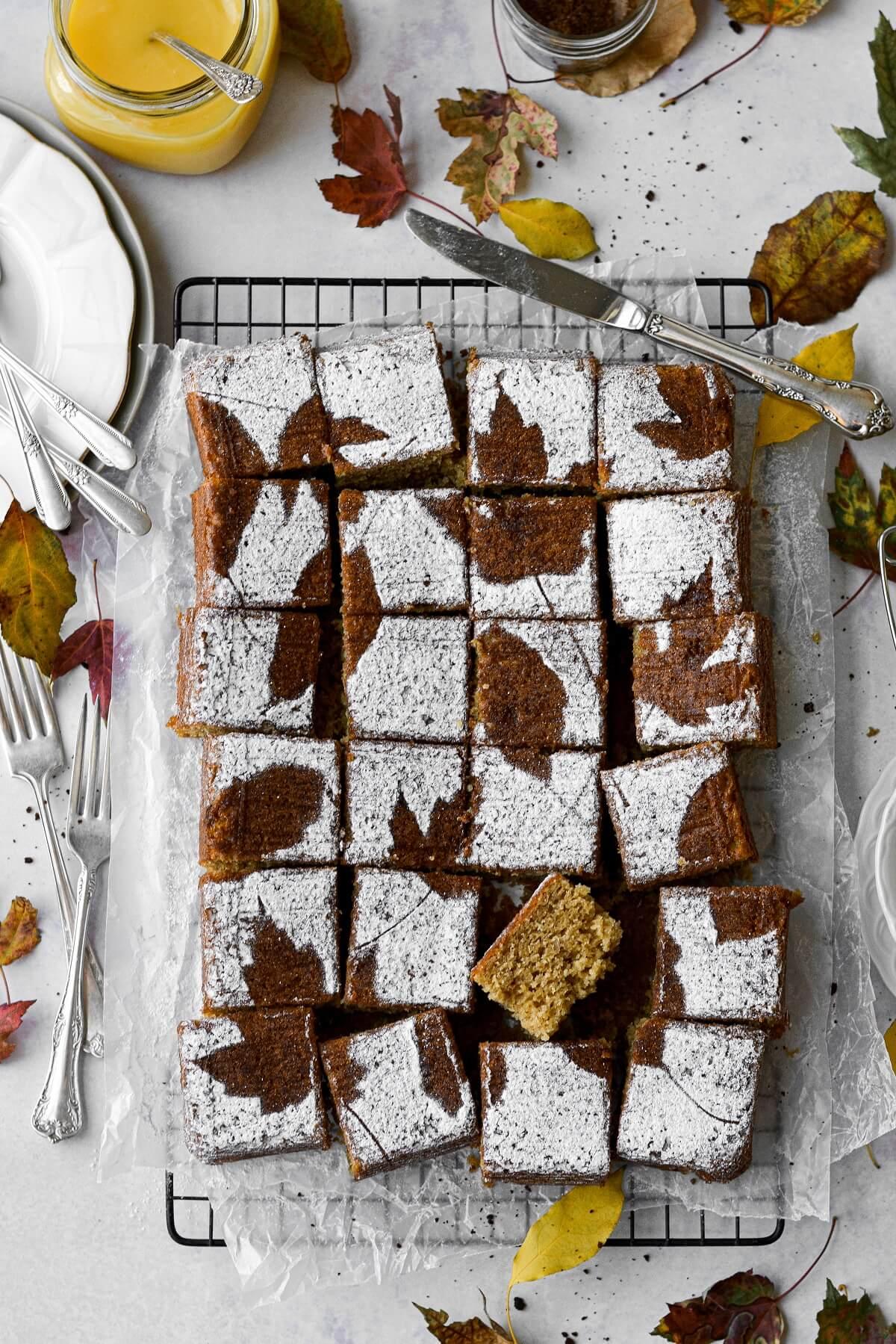 Cardamom ginger cake with powdered sugar leaf stencils.