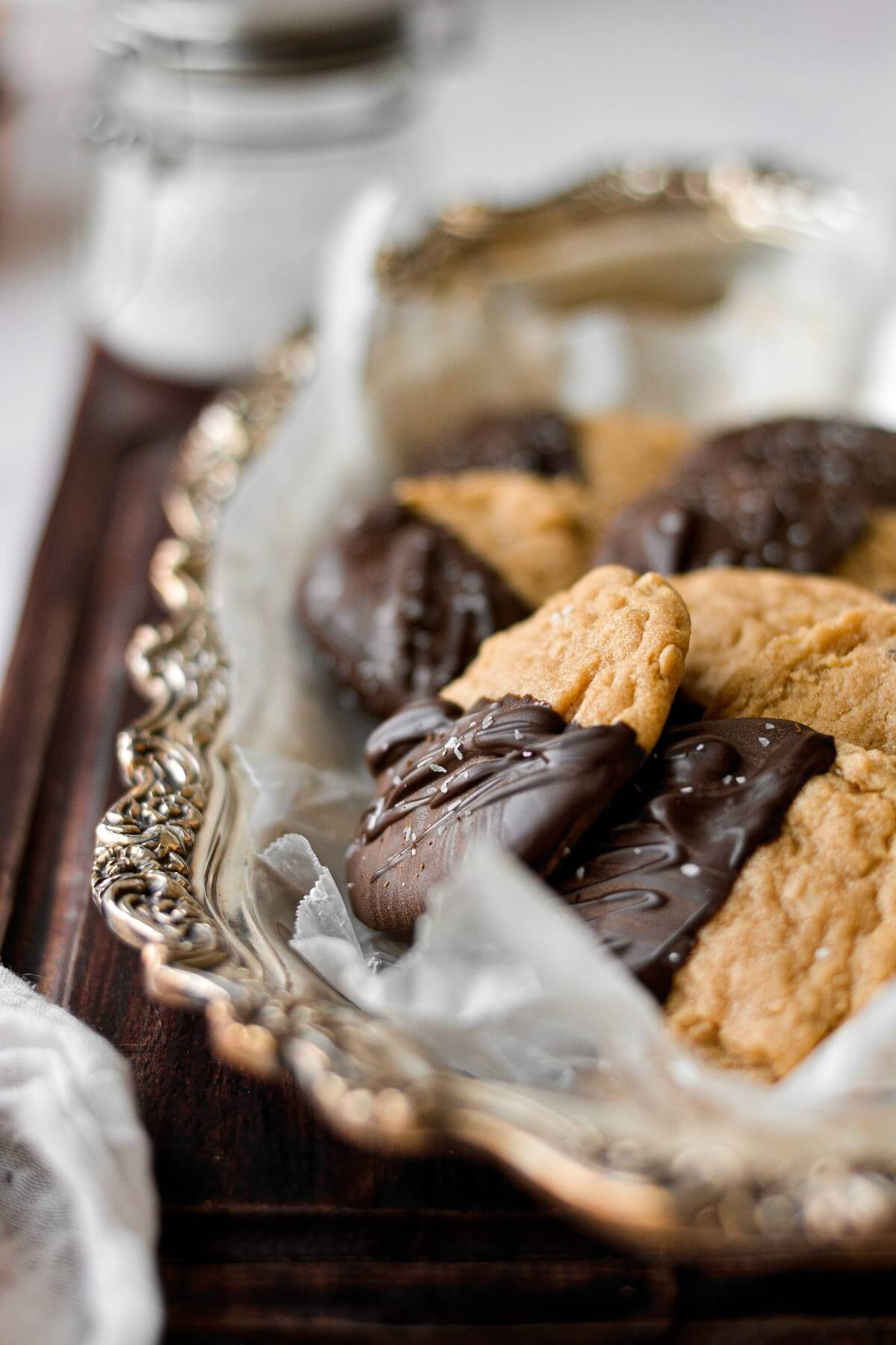 Peanut butter cookies dipped in chocolate and sprinkled with sea salt.
