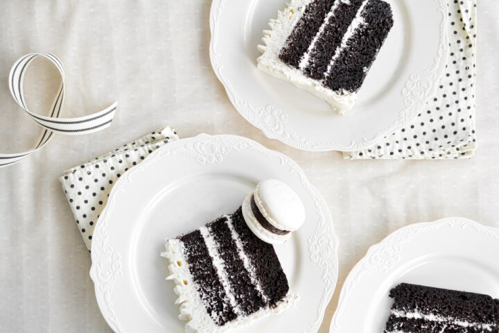 Slices of chocolate cake with vanilla buttercream.