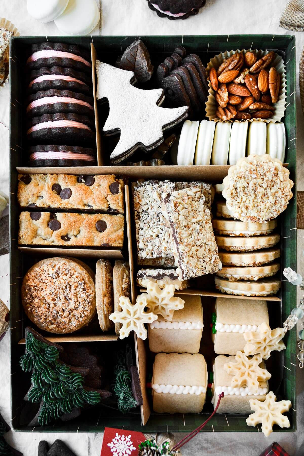 A box full of assorted Christmas cookies.