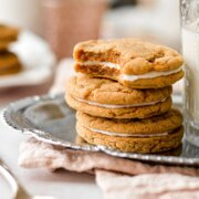 A stack of ginger molasses cookies, filled with lemon icing.