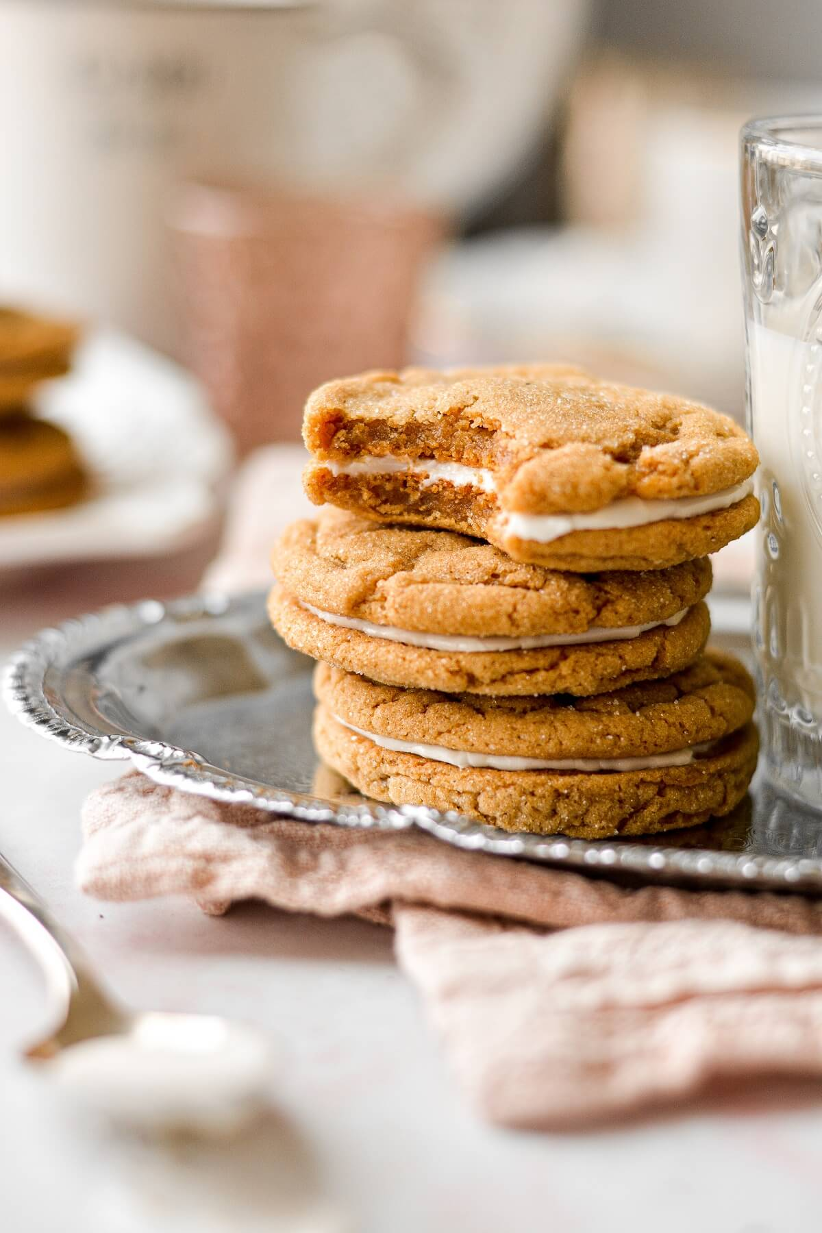 A stack of soft ginger molasses cookies, filled with lemon icing.