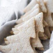 A basket of Christmas tree shaped almond shortbread sugar cookies.