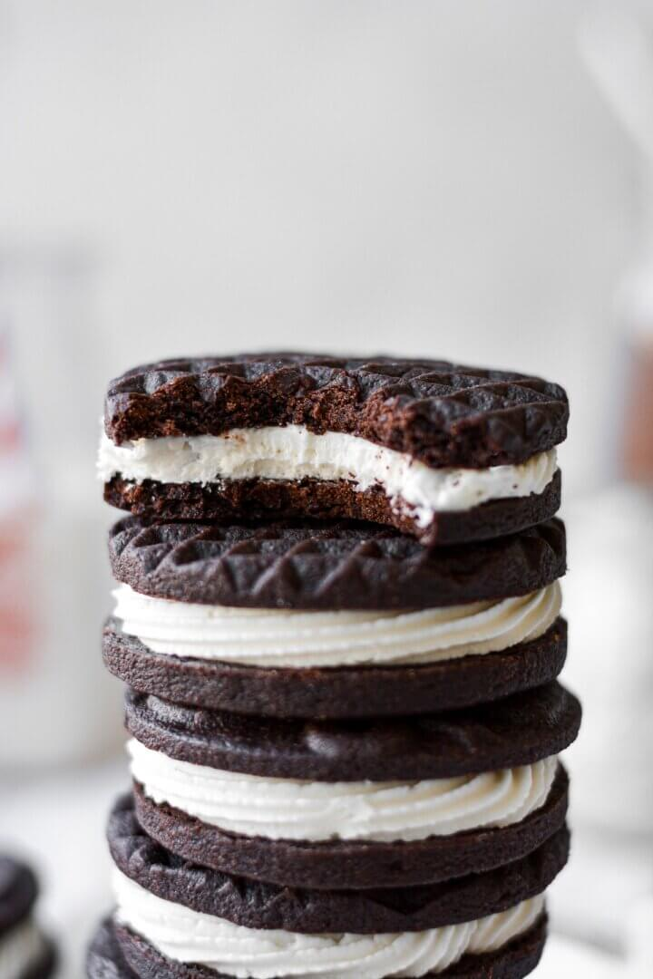 A stack of chocolate sandwich cookies filled with coconut cream frosting.