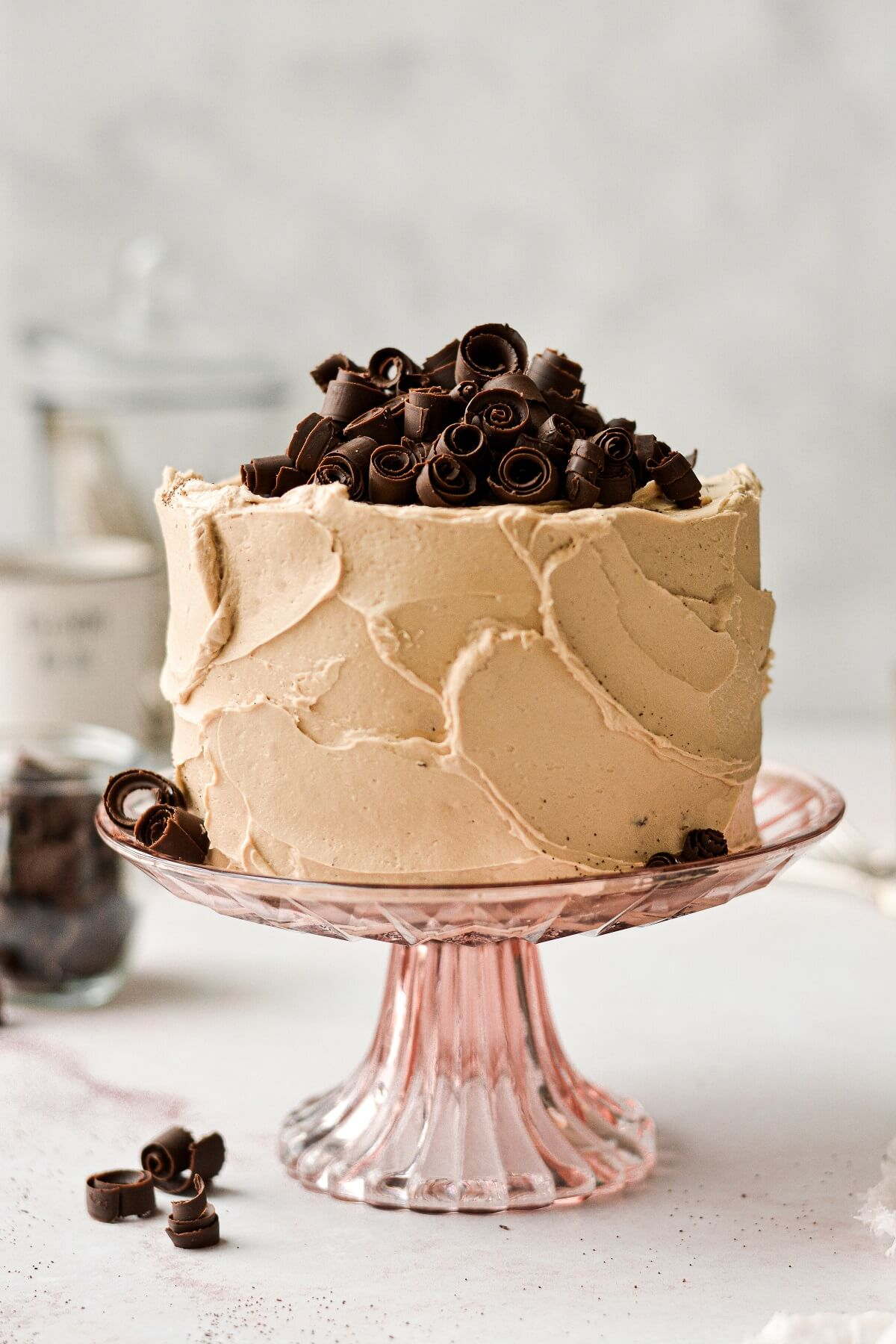Chocolate espresso cake with coffee flavored perfect American buttercream and chocolate curls.
