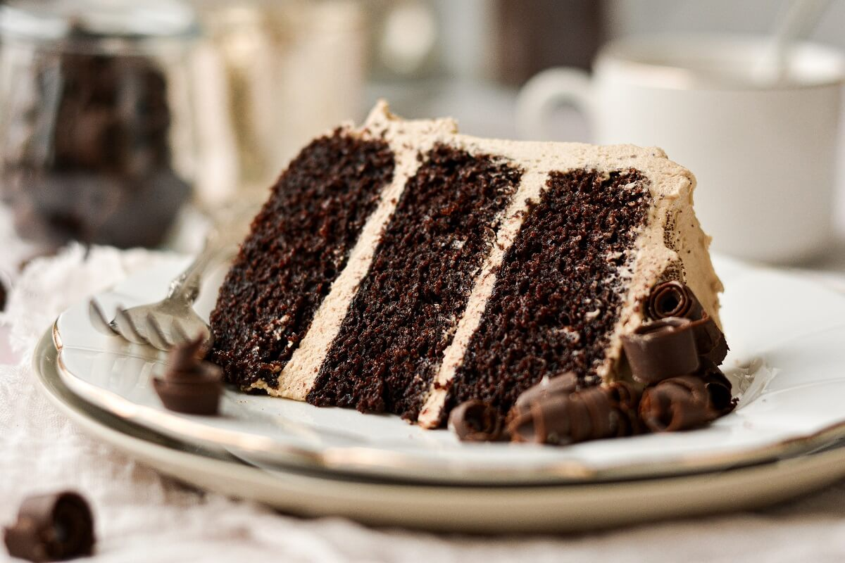 Chocolate espresso cake with coffee buttercream and chocolate curls.