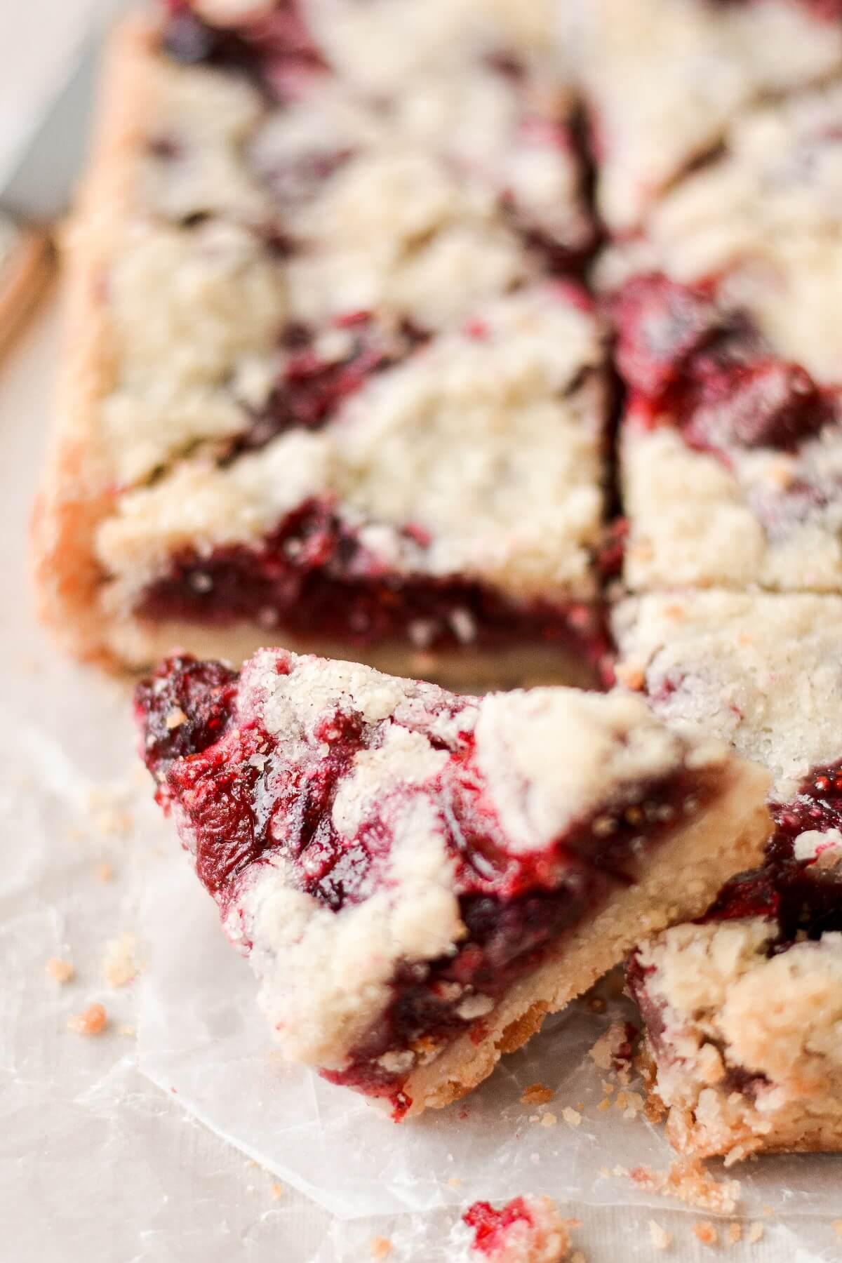 Cranberry almond shortbread crumb bars, cut into triangles.