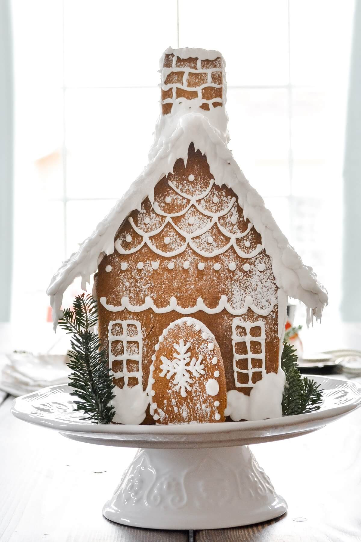 Gingerbread house with icing details.