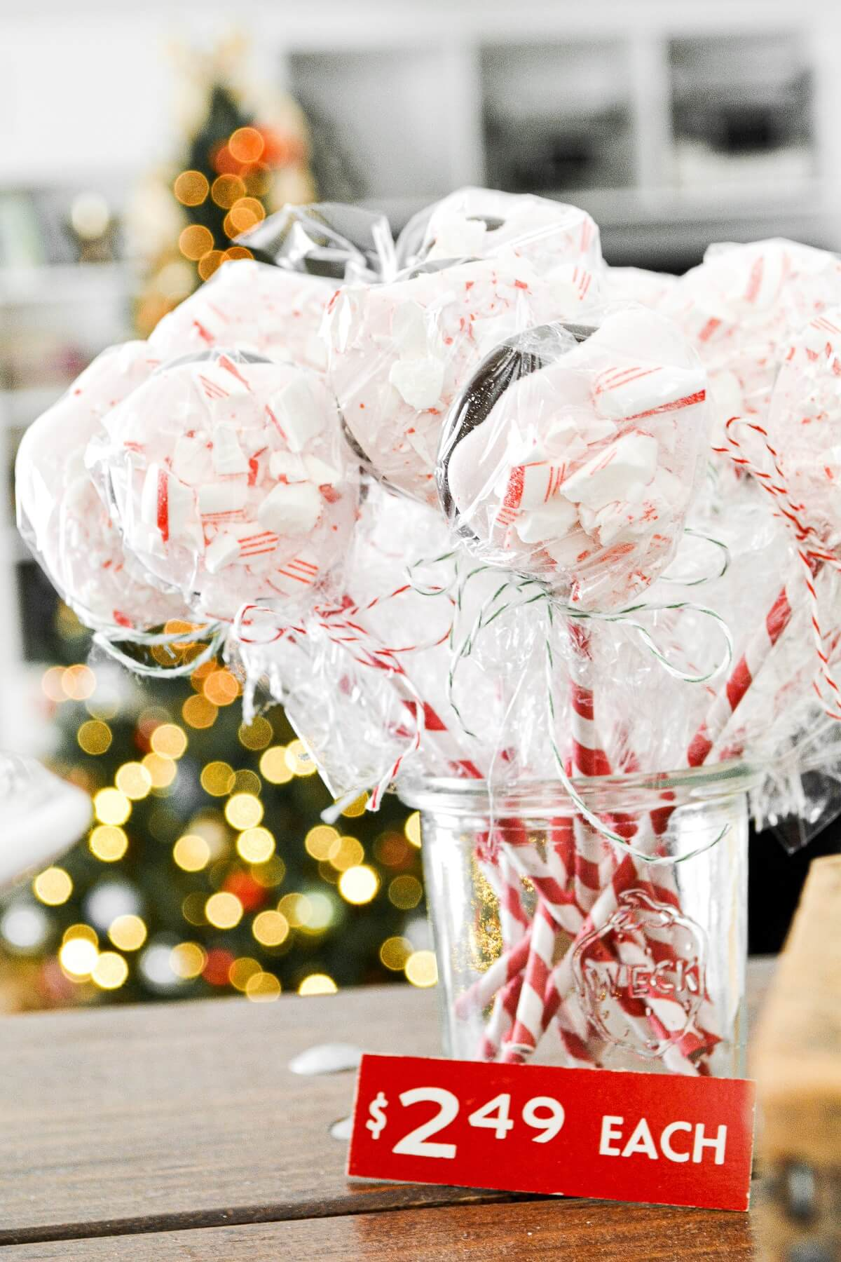 Peppermint bark pops on red and white striped sticks.
