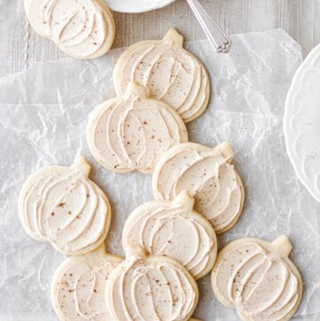 Pumpkin sugar cookies with maple frosting, dusted with nutmeg.