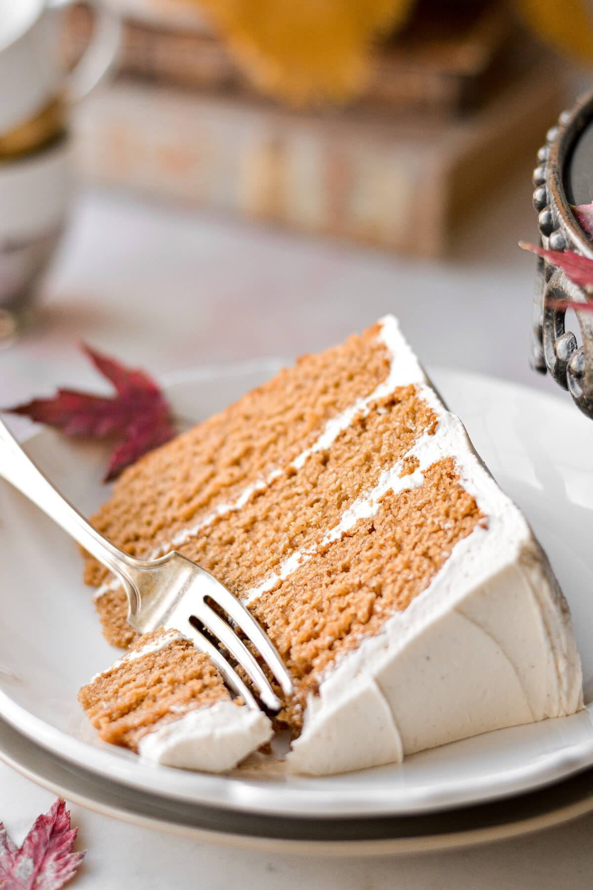 A slice of apple cider cake with maple buttercream.