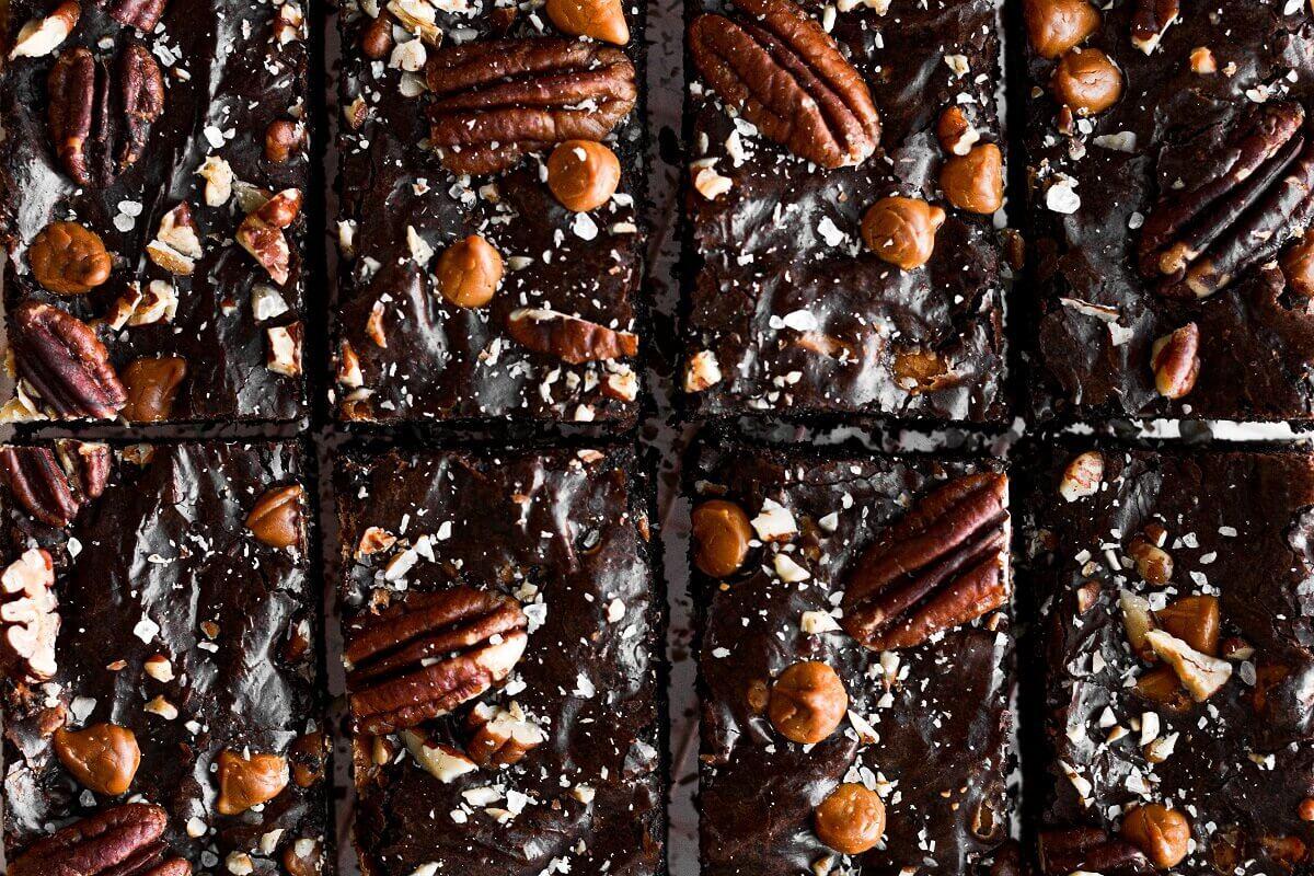Closeup of butter pecan brownies cut into 8 bars.