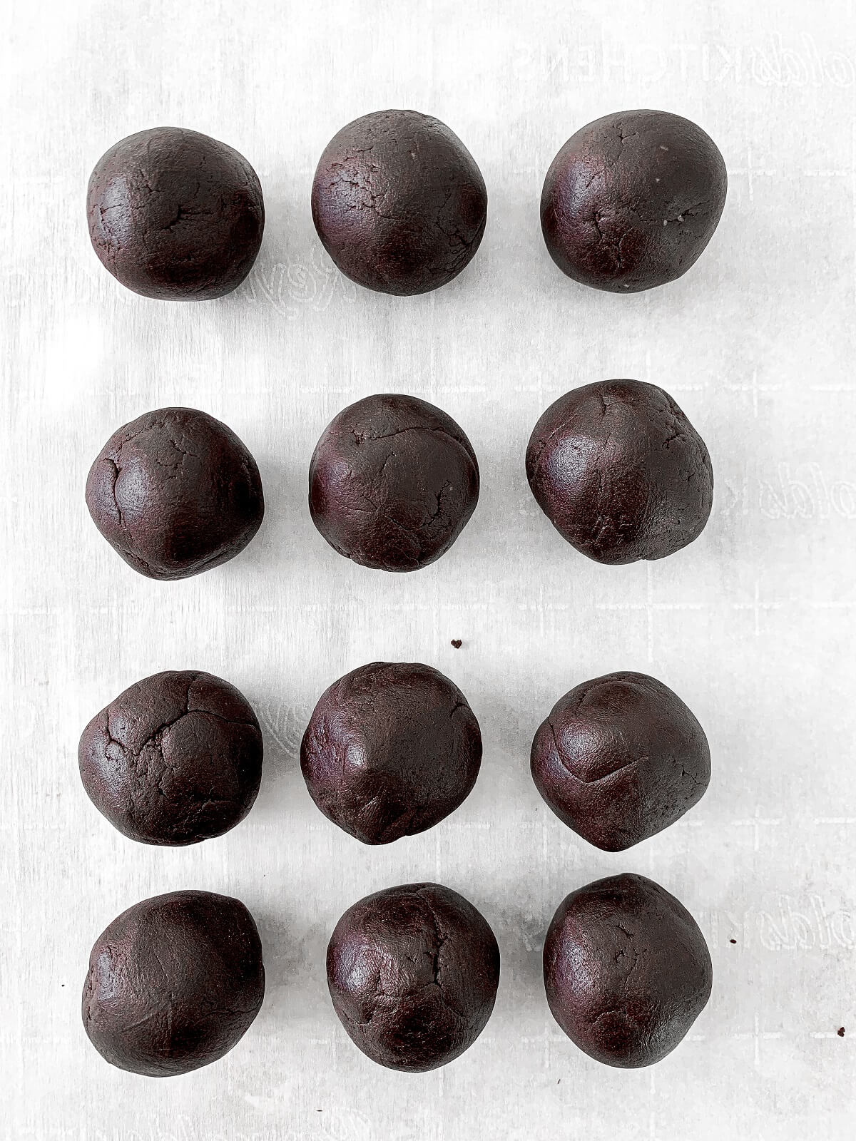 Chocolate shortbread cookie dough, rolled into balls.