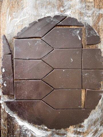Chocolate sugar cookie dough, cut into houses.
