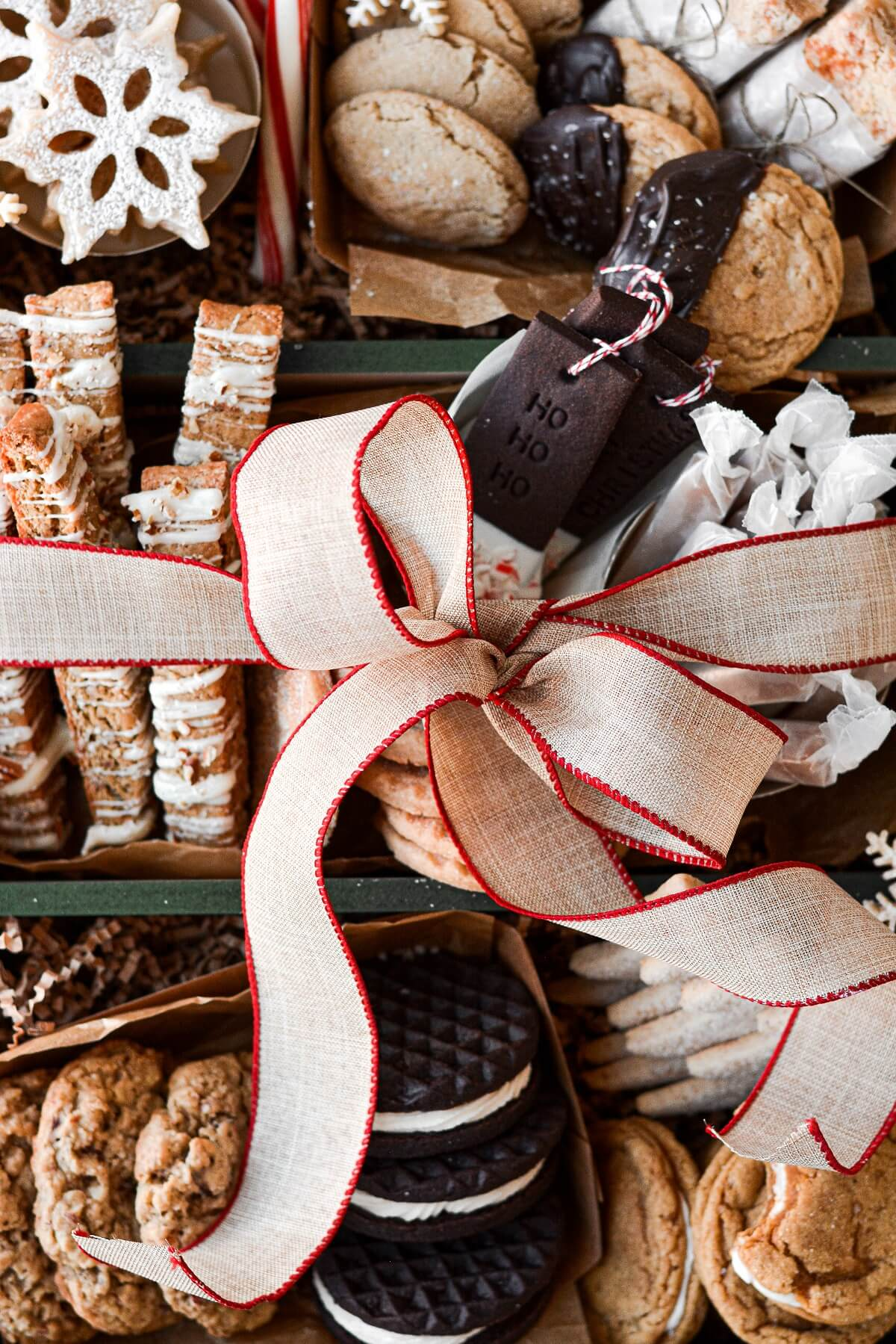A box of Christmas cookies tied with a ribbon.