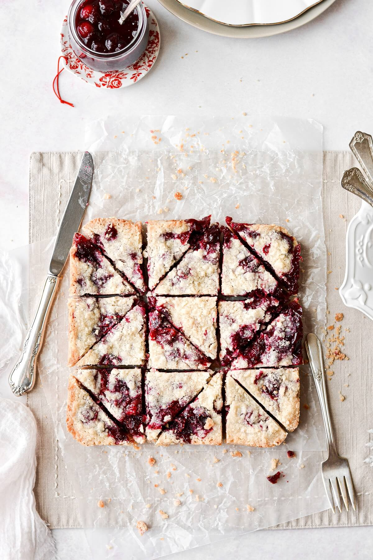 Cranberry almond crumb bars, cut into triangles.