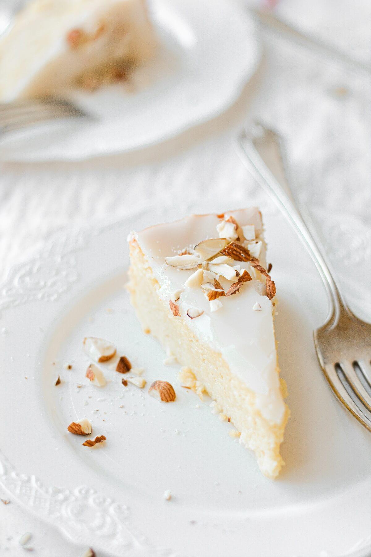 Slices of flourless almond torte on white plates.
