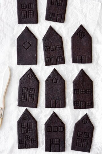 Chocolate sugar cookie houses, ready to be decorated.