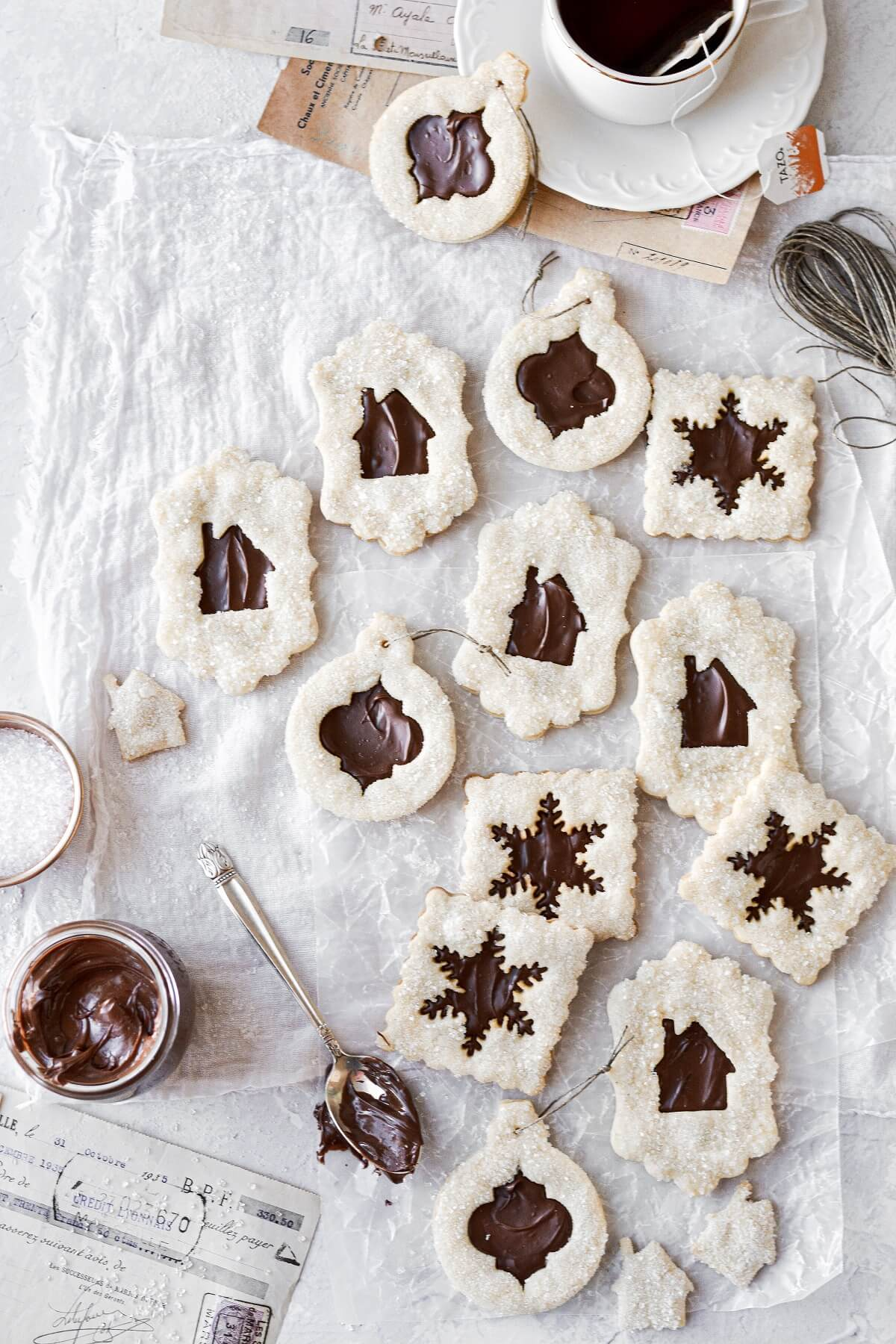 Chocolate hazelnut linzer cookies, with a cup of hot tea.
