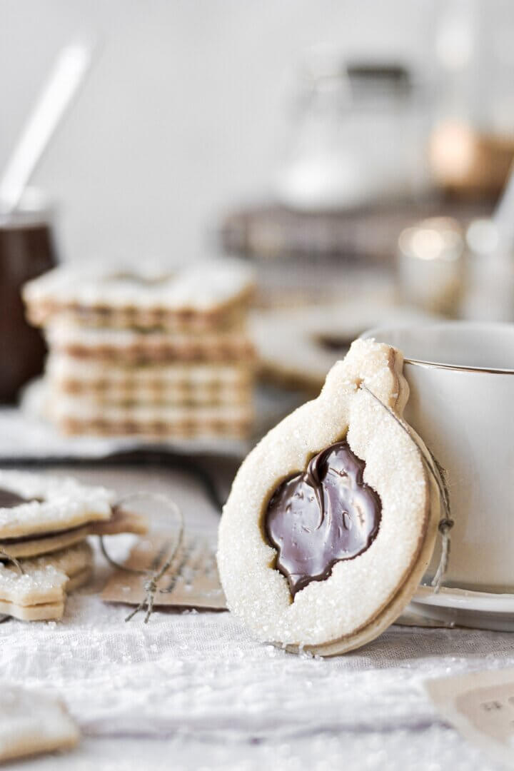 A Christmas ornament shaped chocolate hazelnut linzer cookie.