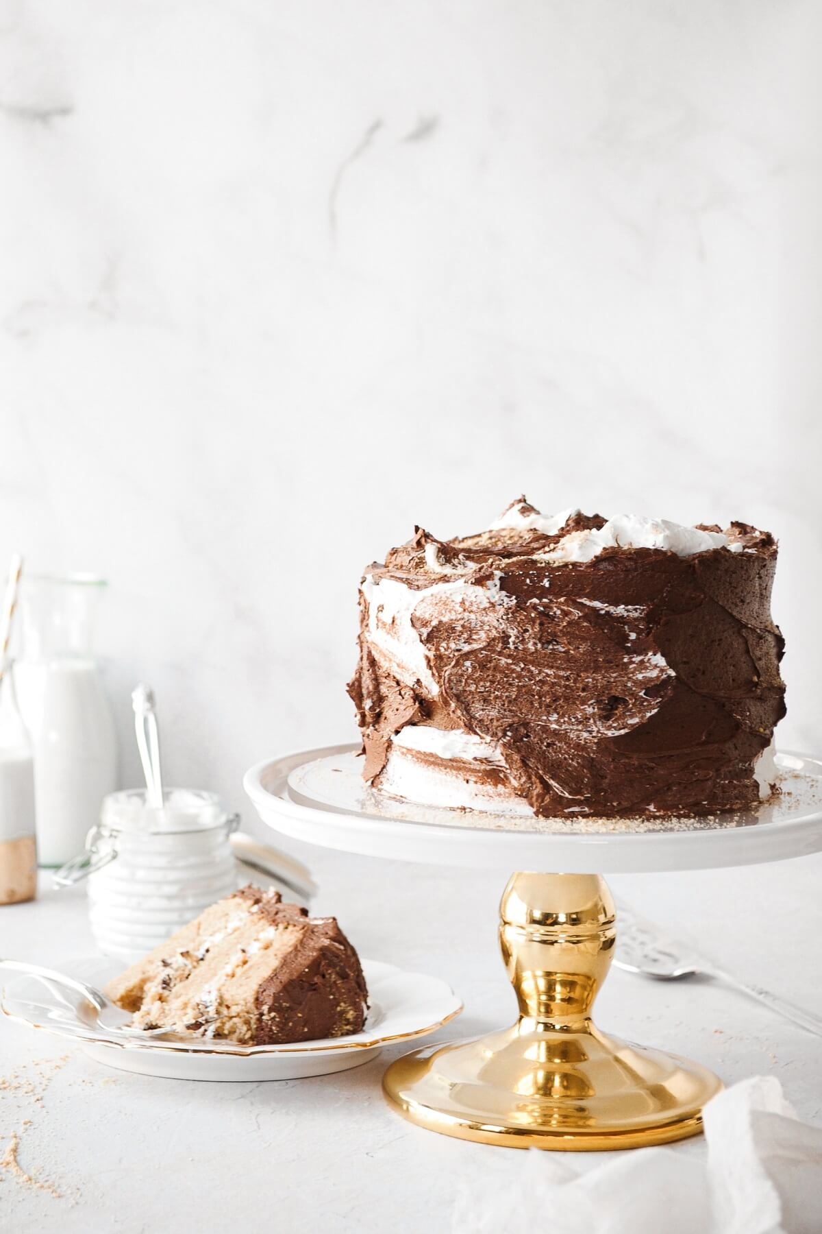 A s'mores cake, with a slice cut.