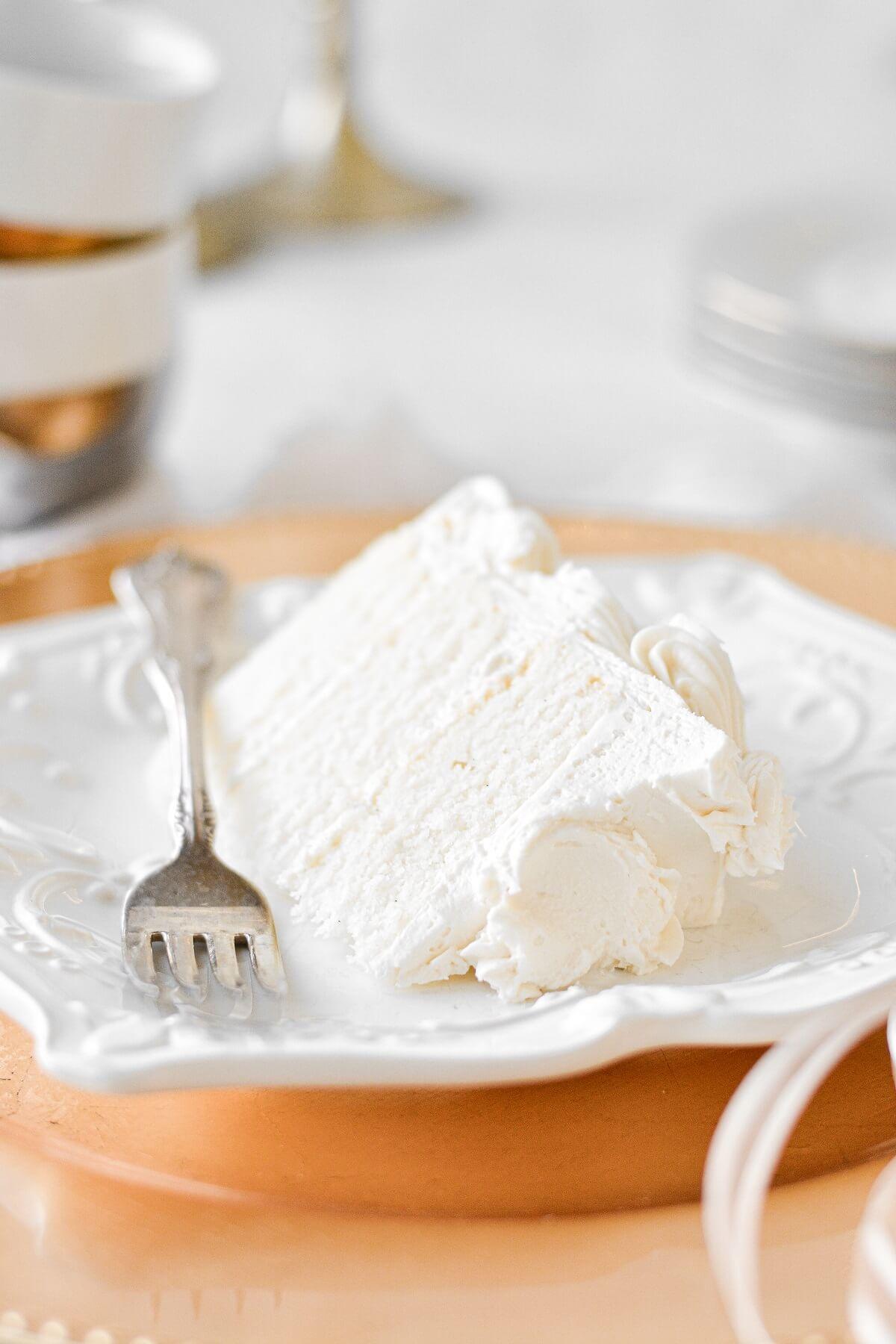 A slice of white velvet cake.