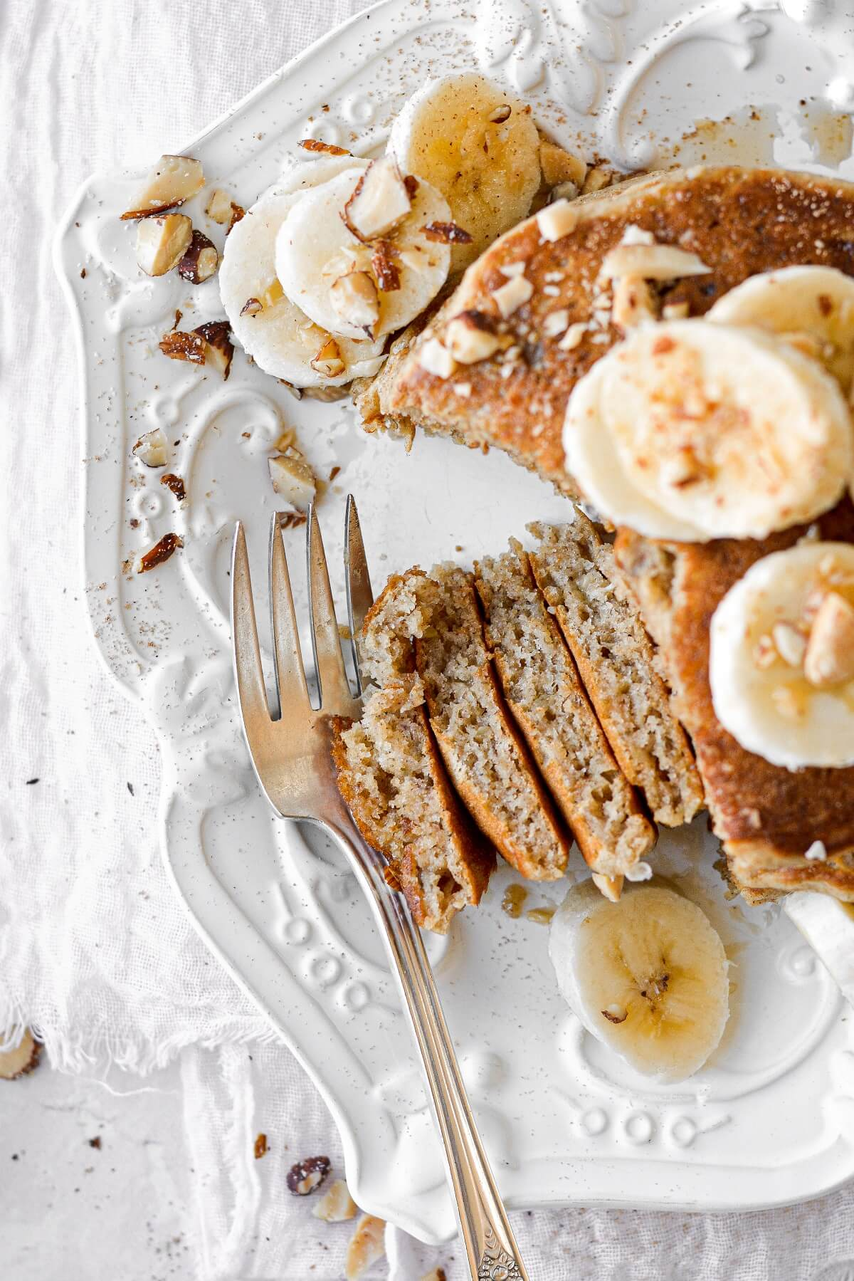 Banana bread pancakes, topped with bananas and almonds.