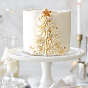 Eggnog cake with a buttercream Christmas tree piped up the side.