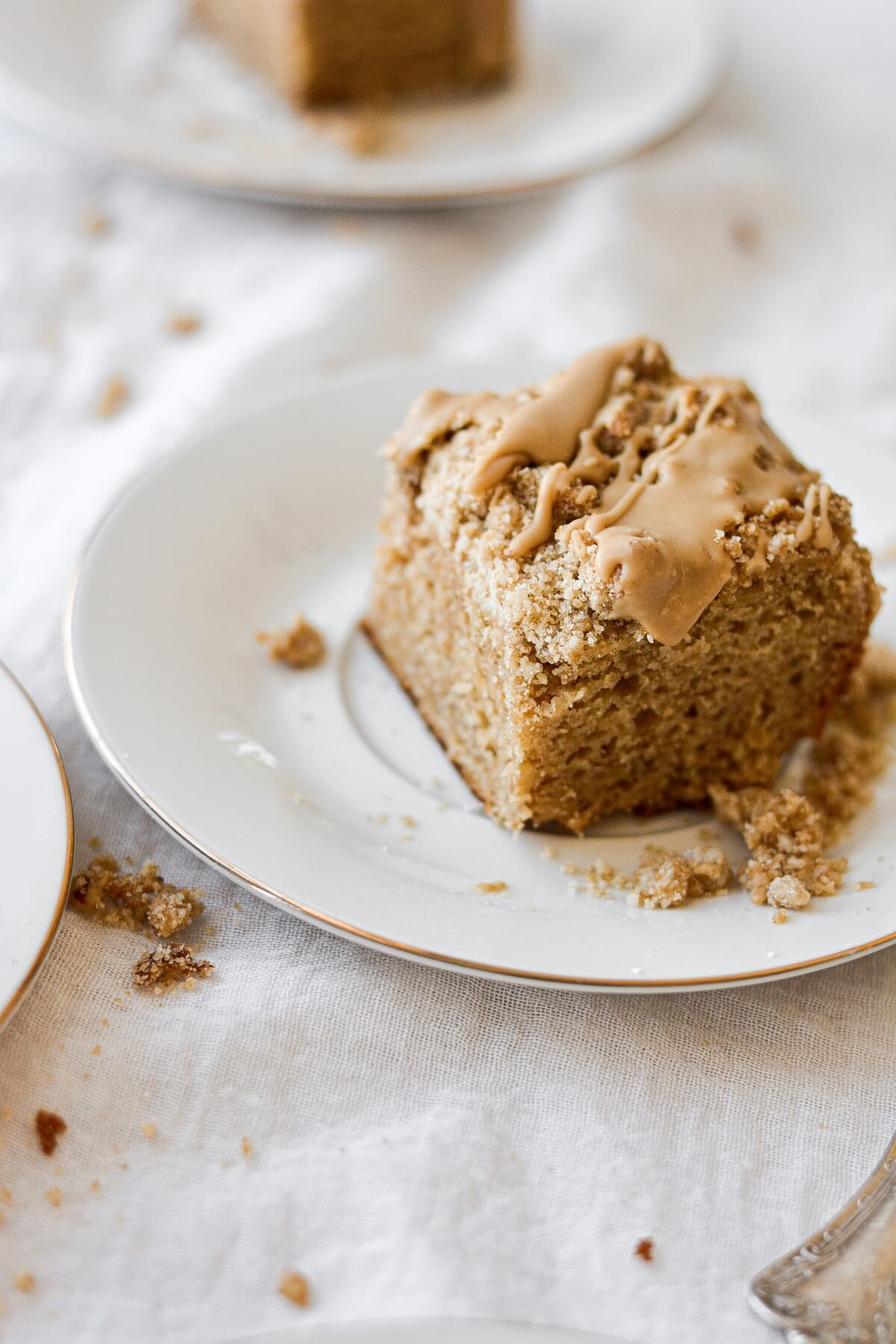 Pieces of gingerbread coffee cake, drizzled with maple icing.