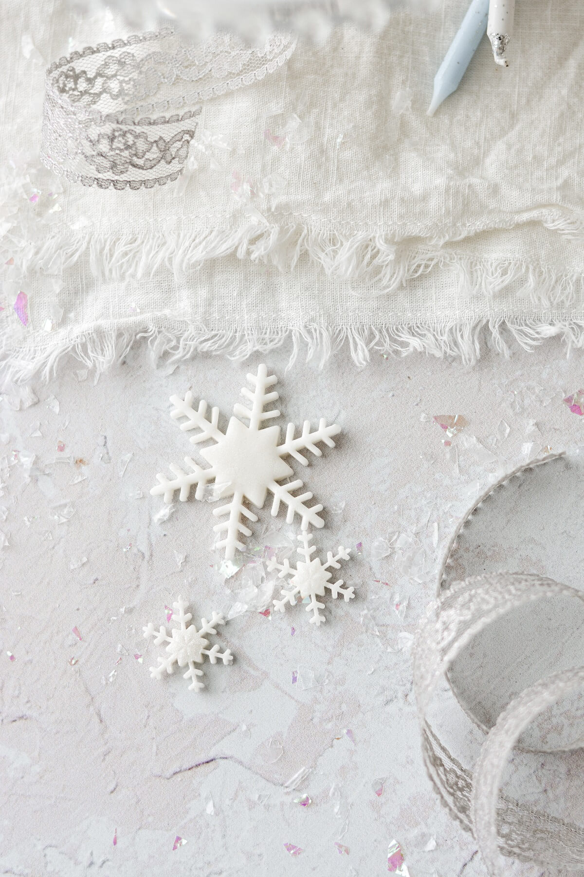 Fondant snowflakes for decorating a cake.