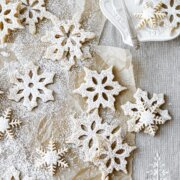 Snowflake shortbread cookies, dusted with powdered sugar.