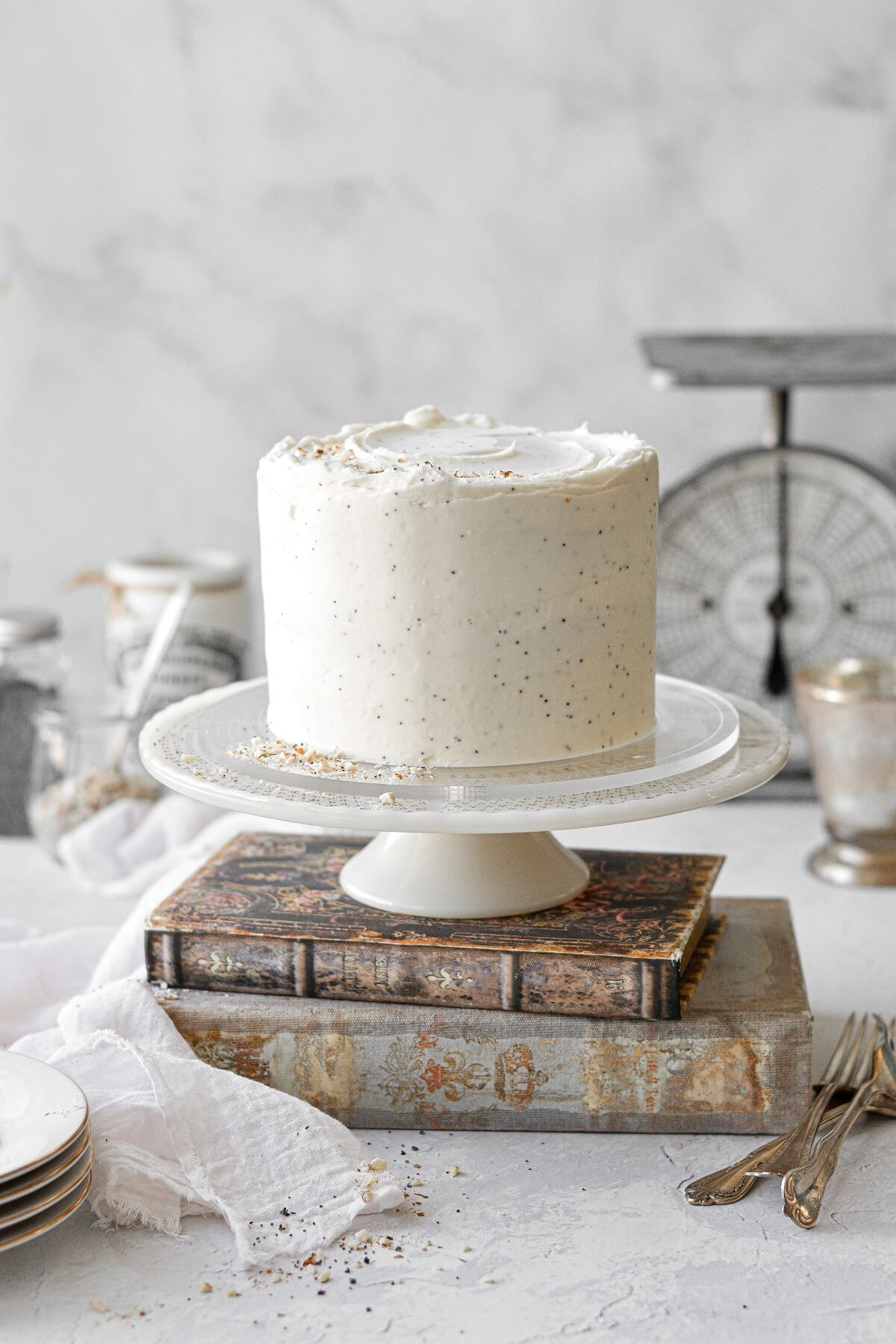 Almond poppyseed cake on a stack of vintage books.