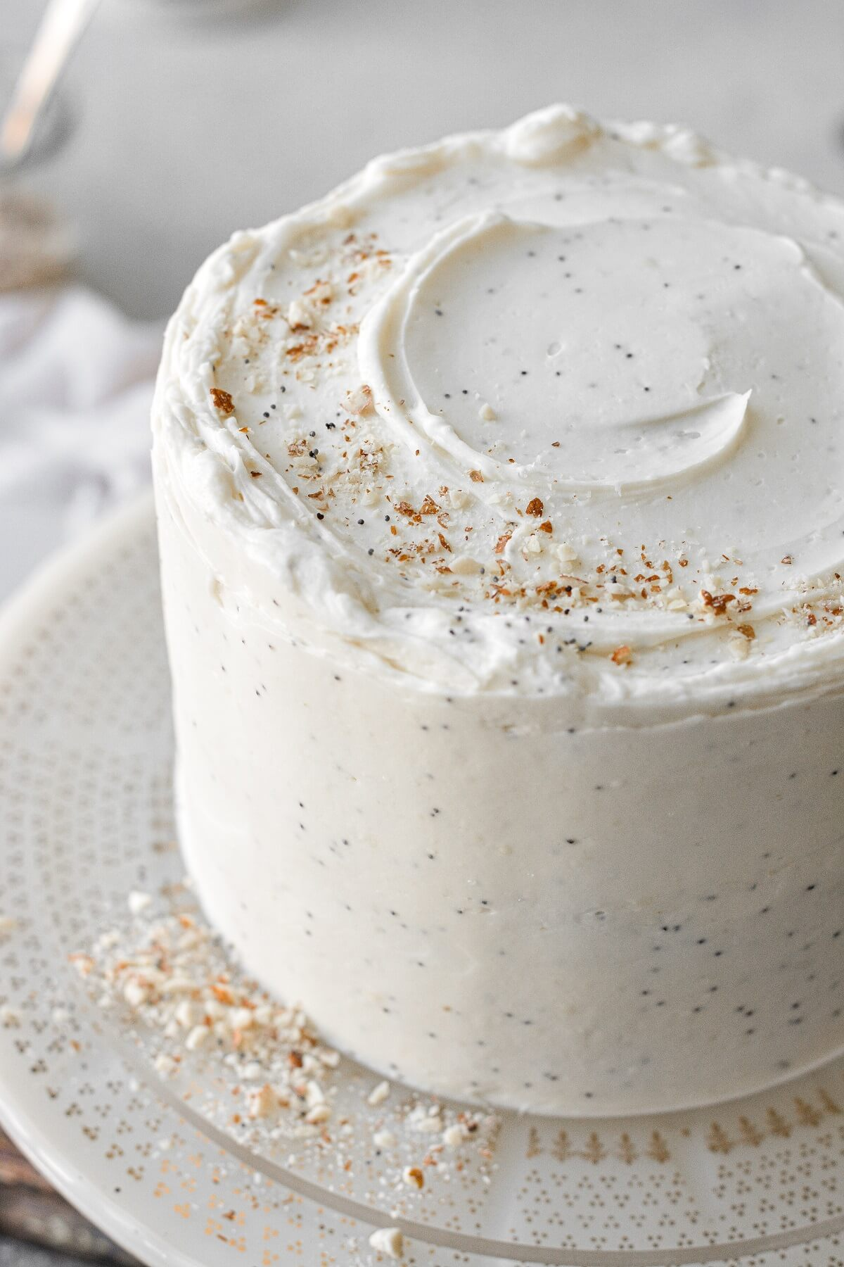 Almond poppyseed cake sprinkled with crushed almonds.