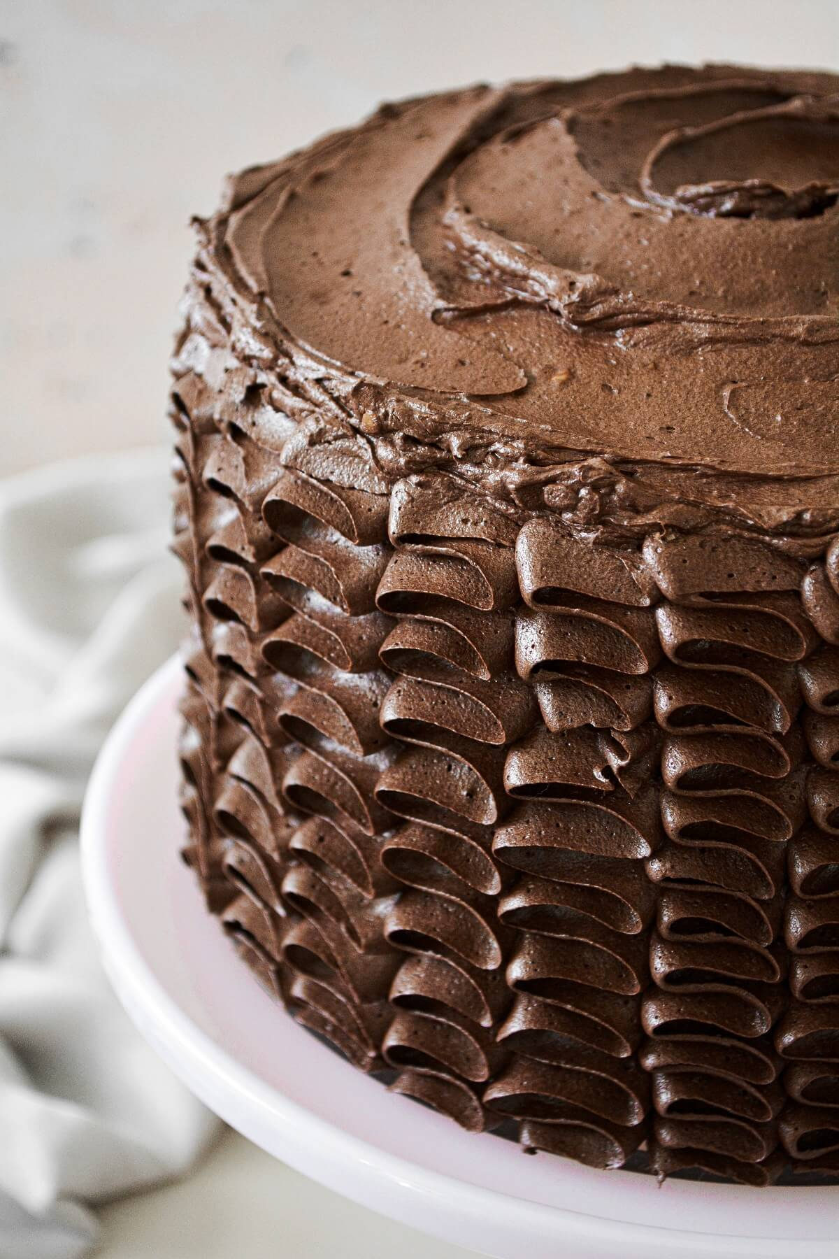 Chocolate caramel toffee cake with piped ruffled buttercream.