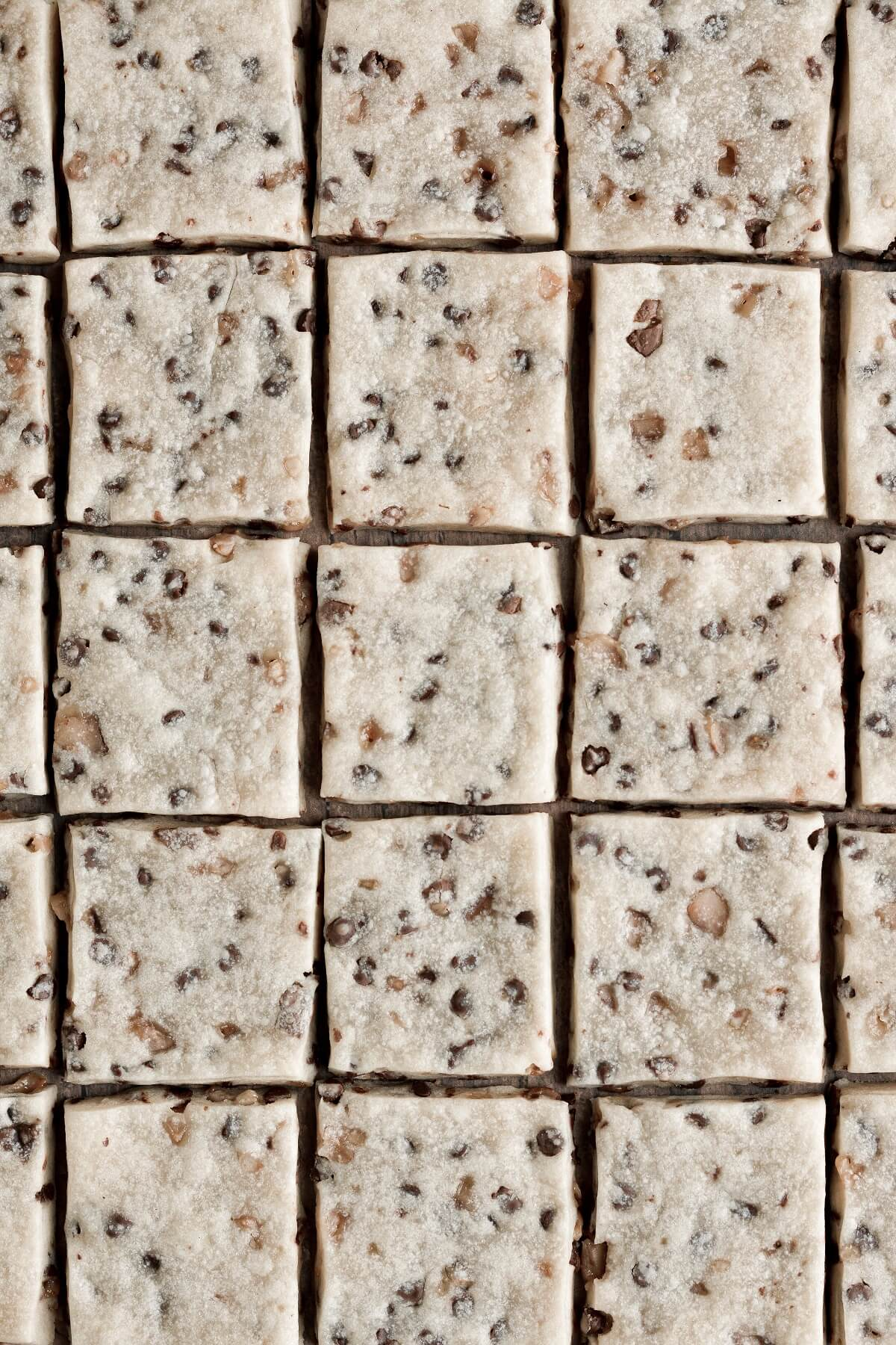 Chocolate chip toffee shortbread, cut into squares and arranged in a grid pattern.