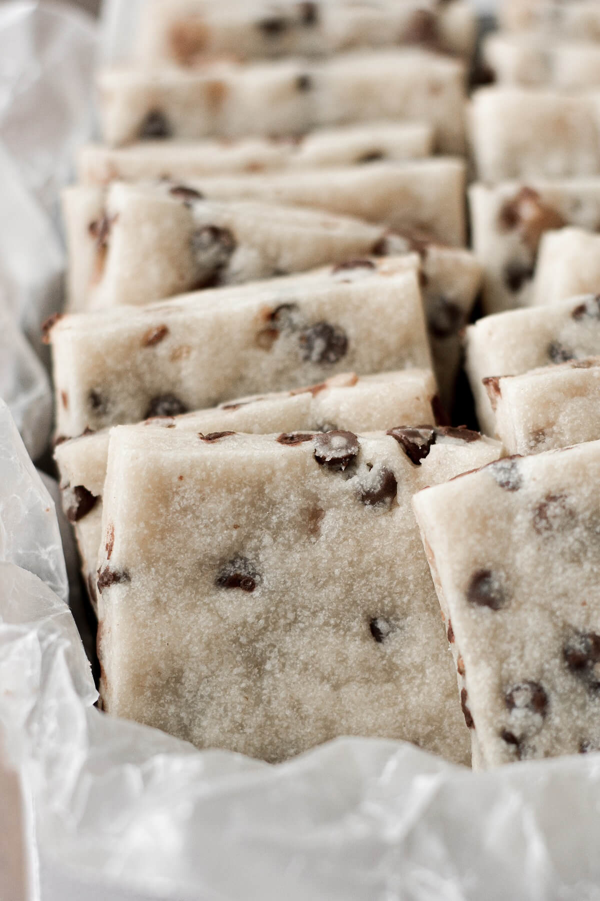 Squares of chocolate chip toffee shortbread.