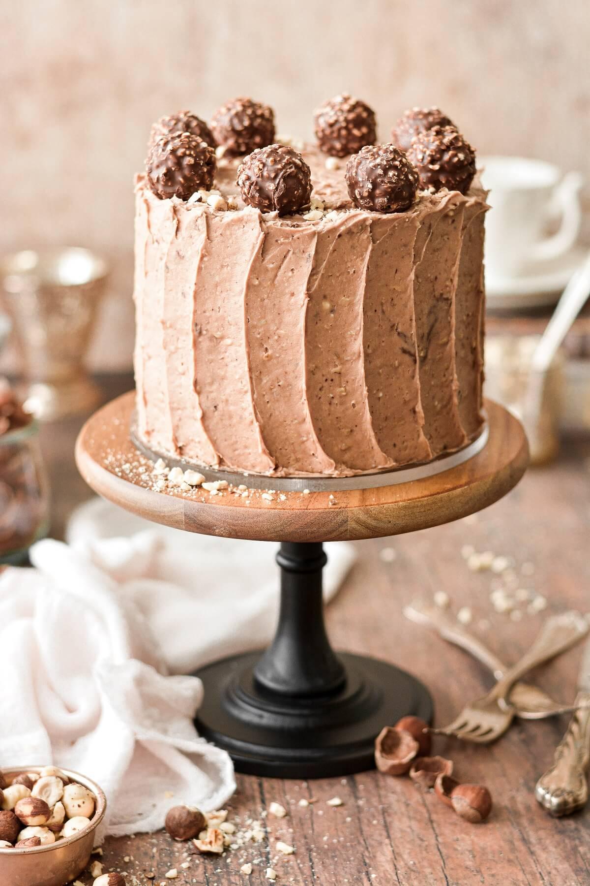 Chocolate hazelnut cake topped with chocolate hazelnut truffles.