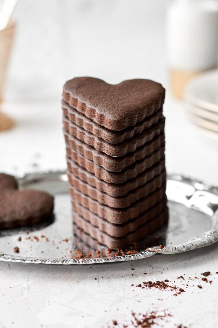 A stack of heart shaped chocolate sugar cookies.