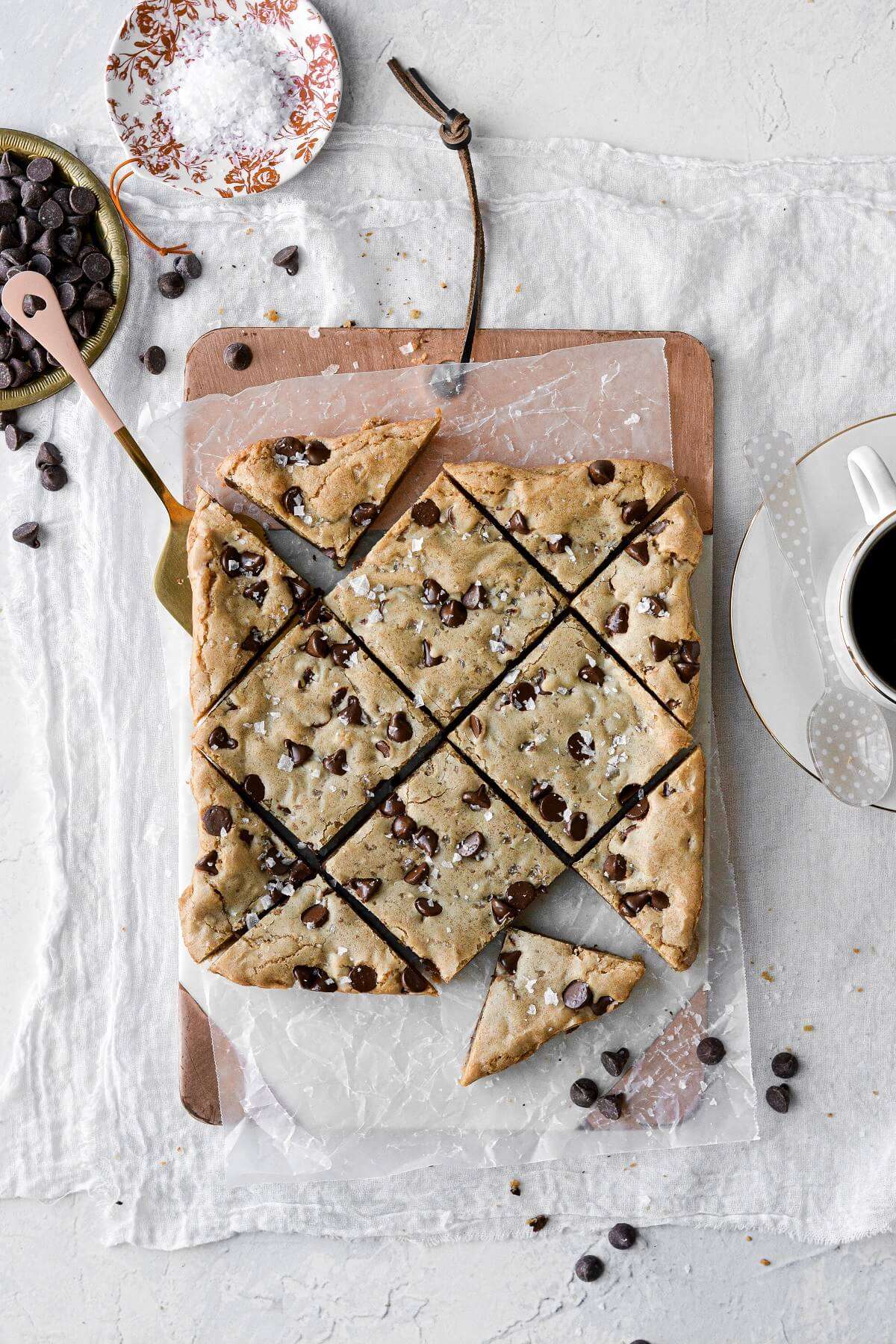 Cookie butter chocolate chip blondies on a cutting board.