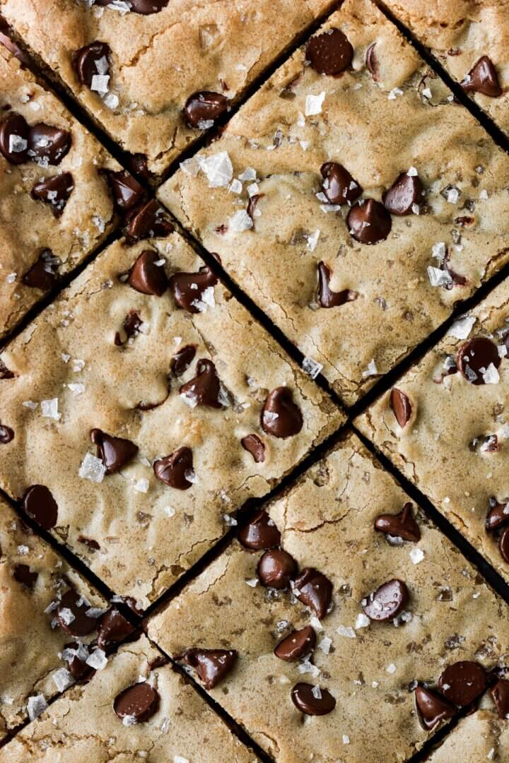 Closeup of squares of cookie butter chocolate chip blondies.