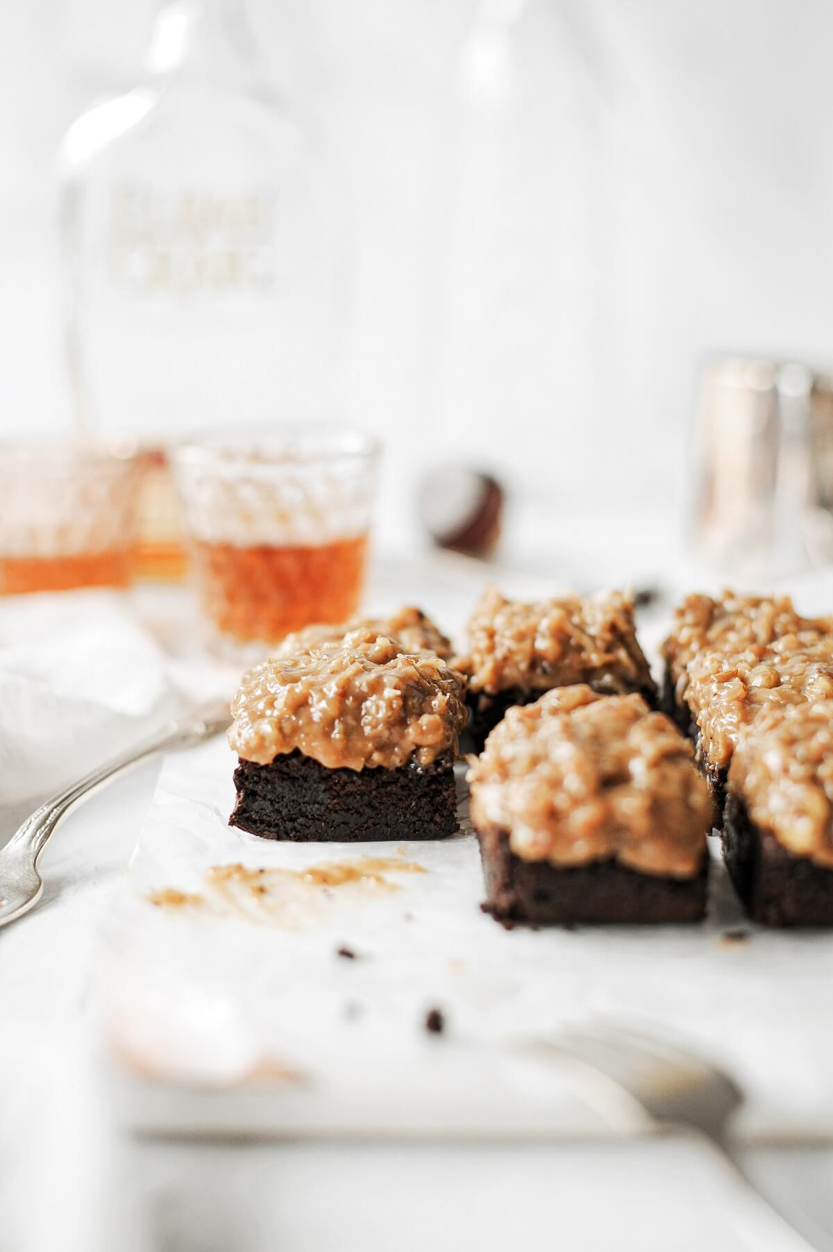 German chocolate bourbon brownies on a marble serving board.